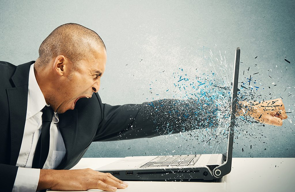 Man putting fist through laptop
